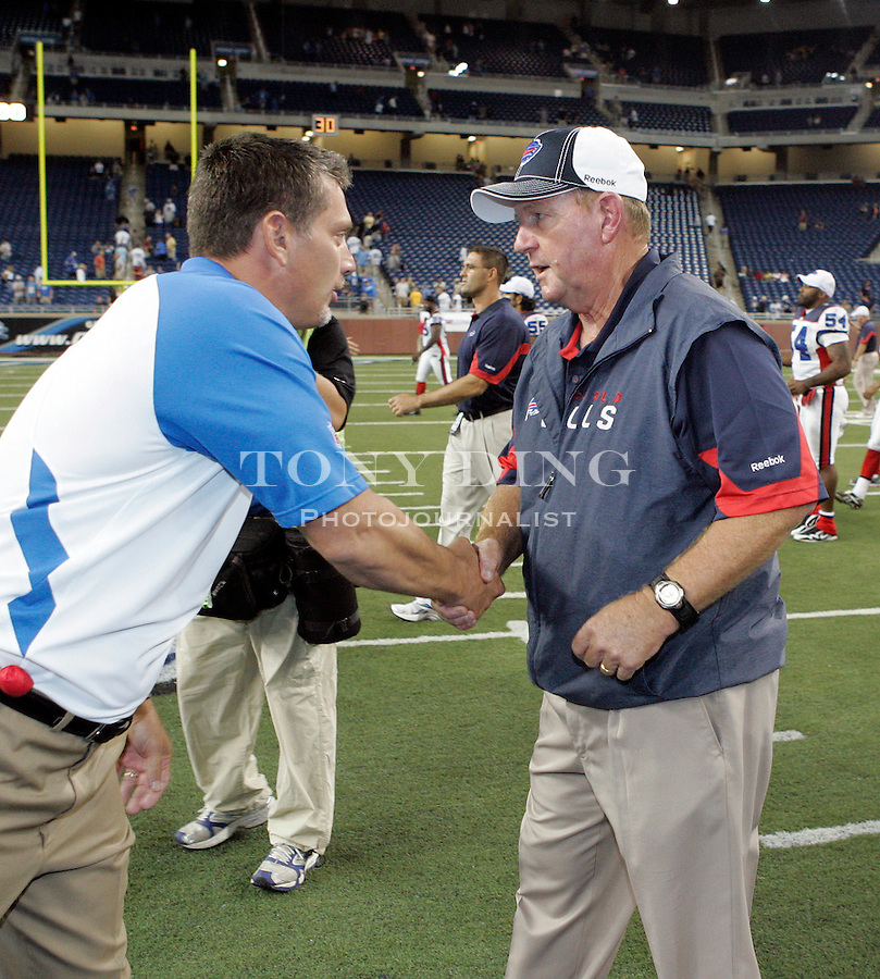 Detroit Lions head coach Jim Schwartz, left, shakes hands with Buffalo Bills head coach Chan Gailey after a preseason NFL football game, Thursday,  Sept. 2, 2010, in Detroit. The Lions won 28-23. (AP Photo/Tony Ding)