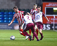 Lincoln City U18's Elliott Sartorius gets away from South Shieldsy U18's Emeraude Yembe, left, and Will McCamley<br /> <br /> Photographer Andrew Vaughan/CameraSport<br /> <br /> The FA Youth Cup Second Round - Lincoln City U18 v South Shields U18 - Tuesday 13th November 2018 - Sincil Bank - Lincoln<br />  <br /> World Copyright © 2018 CameraSport. All rights reserved. 43 Linden Ave. Countesthorpe. Leicester. England. LE8 5PG - Tel: +44 (0) 116 277 4147 - admin@camerasport.com - www.camerasport.com