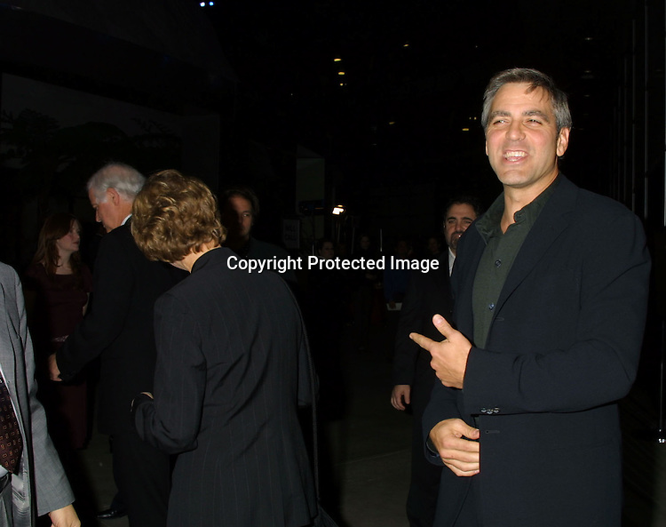 """©2002 KATHY HUTCHINS/HUTCHINS PHOTO.""""SOLARIS"""" PREMIERE.HOLLYWOOD, CA. 11/19/02.GEORGE CLOONEY AND PARENTS"""