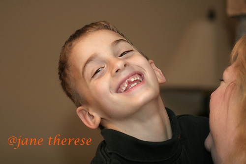 Joseph Salem 8 of Telford, Pa., who just lost his tooth gives a big grin on a cold Thursday March 2, 2006. While still in the orphanage at 10 months, Joseph's twin sister Sophia, would wrestle a bottle of milk away from other babies and give it to her brother Joseph. That act is what kept Joseph alive. Joseph at the age of 1 year, could not even hold his head up. The Salem children, 3 sets of twins, are from Nevel, Russia. Sophia and twin Joseph were adopted at 11 months of age by Hythem and his wife Lisa. The other twins, Selene and Julianne 13 along with Sam and Jake, were adopted just 20 months ago. All children are thriving in school, socially and physically. photo by jane therese
