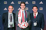 16 January 2014: Patrick Mullins, with technical director Mike Burns (left) and head coach Jay Heaps (right), was selected with the eleventh overall pick by the New England Revolution. The 2014 Major League Soccer SuperDraft was held at the NSCAA Annual Convention in the Pennsylvania Convention Center in Philadelphia, Pennsylvania.