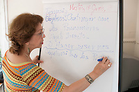 Tutor writing on the board, Spanish class, Adult Learning Centre, Guildford, Surrey.