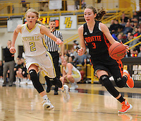 NWA Democrat-Gazette/ANDY SHUPE<br /> Kyrstin Branscum (3) of Gravette drives past Skylar Campbell of Pottsville Wednesday, Feb. 24, 2016, during the second half of play in the 4A North Regional Tournament in Tiger Arena in Prairie Grove. Visit nwadg.com/photos to see more photographs from the game.