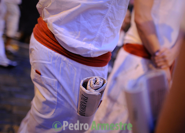 A runner is pictured before the fourth run of the bulls of the San Fermin festival, on July 10, 2012, in the northern Spanish city of Pamplona. The festival is a symbol of Spanish culture that attracts thousands of tourists to watch the bull runs despite heavy condemnation from animal rights groups. (c) Pedro ARMESTRE