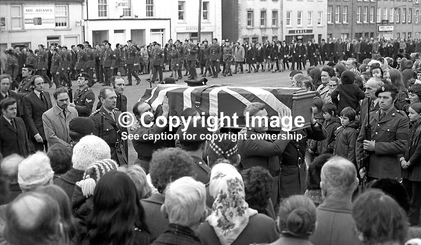 The union jack draped coffin of Cormac McCabe, a UDR Captain,  who was kidnapped and murdered by the Provisional IRA, is carried into the local church in his home town of Aughnacloy, Co Tyrone on 22nd January 1974. Mr McCabe's body was found a short distance inside N Ireland on the Tyrone-Monaghan border near Clogher. Mr McCabe, from Aughnacloy, was the headmaster of a local school and a close friend of Ulster Unionist Westminister MP, Ken Maginnis. Mr McCabe was kidnapped by the Provisional IRA from a hotel in Monaghan town where he was having lunch with his wife and family. Mr McCabe was kidnapped on Saturday, 19th January 1971, his body was recovered on Sunday 20th January and his funeral was on 22nd January 1974. 197401200026c.<br />