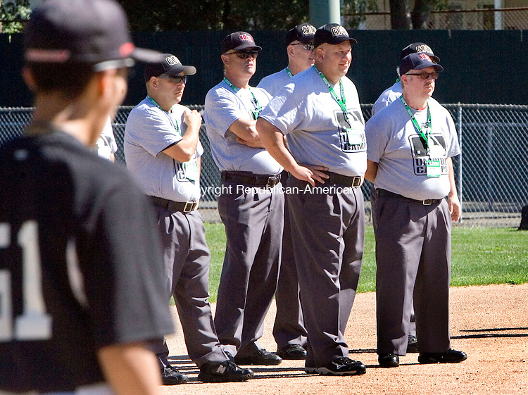 BRISTOL CT. 23 August 2013-082413SV18-Umpires participate in a drill at umpire camp at Muzzy Field in Bristol Saturday. The Major League Baseball umpiring clinic was run by 6 former major league umpires, which about 120 local umpires attended. <br /> Steven Valenti Republican-American