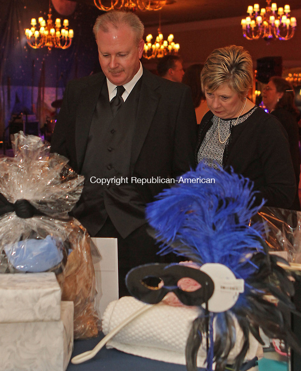 Plantsville, CT-020114MK01 Marty and Debbie Stokes look over items up for bid during Saint Mary's Hospital Foundation  second Anniversary Gala 2014, A Night in Venice,  at the Aqua Turf in Plantsville on Saturday night. Co-Chairmen, Dr. J. Alexander Palesty and Mrs. Abagail E. Palesty with Mr. Richard M. Sills and Robin M. Sills,lead the Gala committee in planning the celebration. The 2014 gala included a gourmet dinner, live and silent auctions and live entertainment. The foundation's goal for 2014 was to raise $400,000. Michael Kabelka / Republican-American