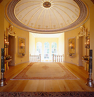 A hand-painted and gilded domed ceiling makes the spacious first floor landing appear even greater in size