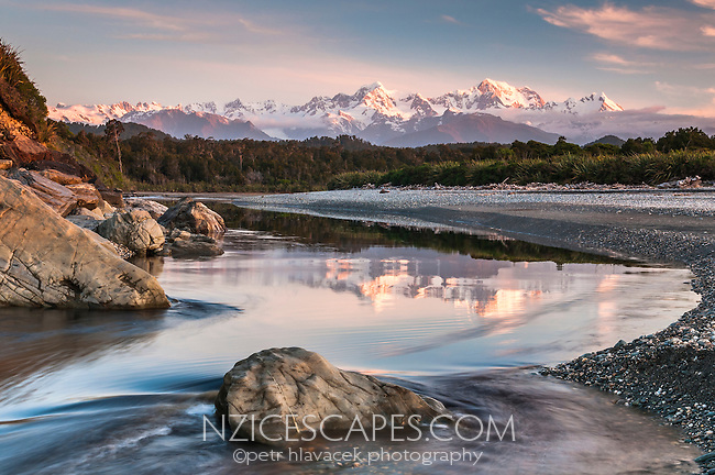 Southern Alps with Fox Glacier, Mt. Cook and Mt. Tasman photographed from Gillespies beach after sunset, Westland National Park, West Coast, World Heritage Area, New Zealand