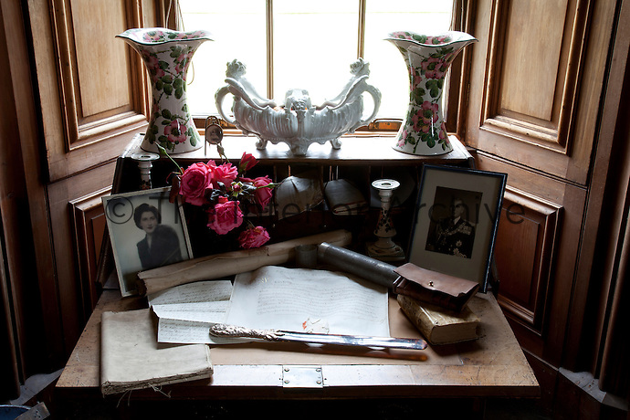 The bureau in the library stores an array of family ephemera and ornaments