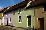 Colourful pastel coloured old cottages in New Street, Woodbridge, Suffolk, England