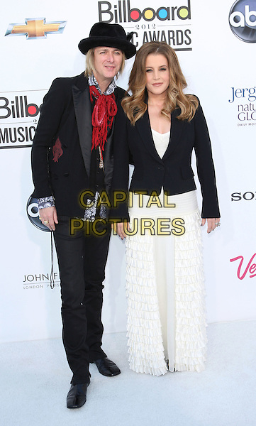 Michael Lockwood & Lisa Marie Presley.Arriving at the 2012 Billboard Music Awards at MGM Grand in Las Vegas, Nevada, USA..May 20th, 2012.full length black white red hat jacket trousers.CAP/ROT/TM.©Tony Michaels/Roth Stock/Capital Pictures