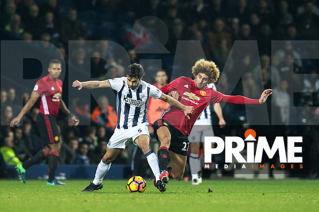 Marouane Fellaini of Manchester United battles Claudio Yacob of West Bromwich Albion during the EPL - Premier League match between West Bromwich Albion and Manchester United at The Hawthorns, West Bromwich, England on 17 December 2016. Photo by Andy Rowland / PRiME Media Images.