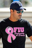 5 November 2011:  FIU Assistant Coach Ignacio Gayo watches as his swimmers warm up prior to the meet.  The FIU Golden Panthers won the meet with the Florida Atlantic University Owls and Florida Southern Moccasins at the Biscayne Bay Campus Aquatics Center in Miami, Florida.