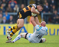 Tom Lindsay of London Wasps is brought down by Craig Gillies of Worcester Warriors during the Aviva Premiership match between London Wasps and Worcester Warriors at Adams Park on Sunday 7th October 2012 (Photo by Rob Munro)
