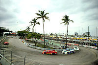 MIAMI, FL - FEBRUARY 26: The #30 MOMO Corse Alba/Momo AR3 001/Ford of Gianpiero Moretti and Oscar Larrauri exits the hairpin turn during the Budweiser Grand Prix of Miami IMSA GTP race on the temporary street circuit in Bicentennial Park in Miami, Florida, on February 26, 1984.