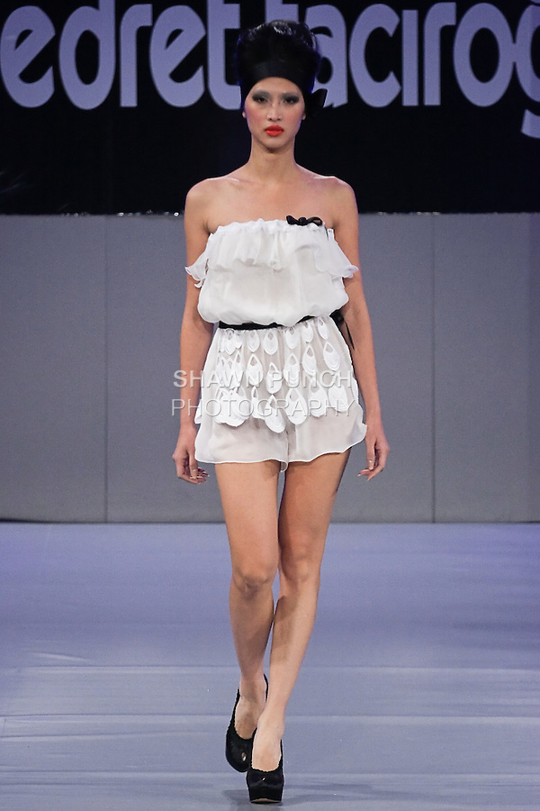 Model walks the runway in an outfit by Turkish couture designer Nedret Taciroglu, for the Nedret Taciroglu Spring 2012 collection, during Couture Fashion Week Spring 2012.
