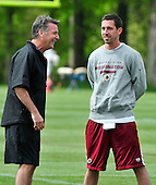 Washington Redskin General Manager Bruce Allen, left, and Offensive Coordinator Kyle Shanahan, right, enjoy a light moment as players participate in the Washington Redskins' rookie minicamp at Redskins Park in Ashburn, Virgina on Sunday, May 5, 2013..Credit: Ron Sachs / CNP
