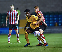 Wolverhampton Wanderers U21's Niall Ennis shields the ball from Lincoln City's Adam Crookes<br /> <br /> Photographer Andrew Vaughan/CameraSport<br /> <br /> The EFL Checkatrade Trophy Northern Group H - Lincoln City v Wolverhampton Wanderers U21 - Tuesday 6th November 2018 - Sincil Bank - Lincoln<br />  <br /> World Copyright © 2018 CameraSport. All rights reserved. 43 Linden Ave. Countesthorpe. Leicester. England. LE8 5PG - Tel: +44 (0) 116 277 4147 - admin@camerasport.com - www.camerasport.com