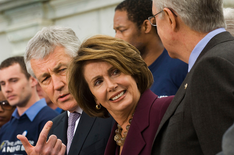 "WASHINGTON, DC - April 29: Sen. Chuck Hagel, R-Neb., House Speaker Nancy Pelosi, D-Calif., and Senate Majority Leader Harry Reid, D-Nev., during a rally with veterans in support of the  ""Post-9/11 Veterans Educational Assistance Act"" (S.22/ H.R. 5740), which would provide veterans of the conflicts in Iraq and Afghanistan educational benefits similar to benefits provided to veterans of the World War II era. (Photo by Scott J. Ferrell/Congressional Quarterly)"