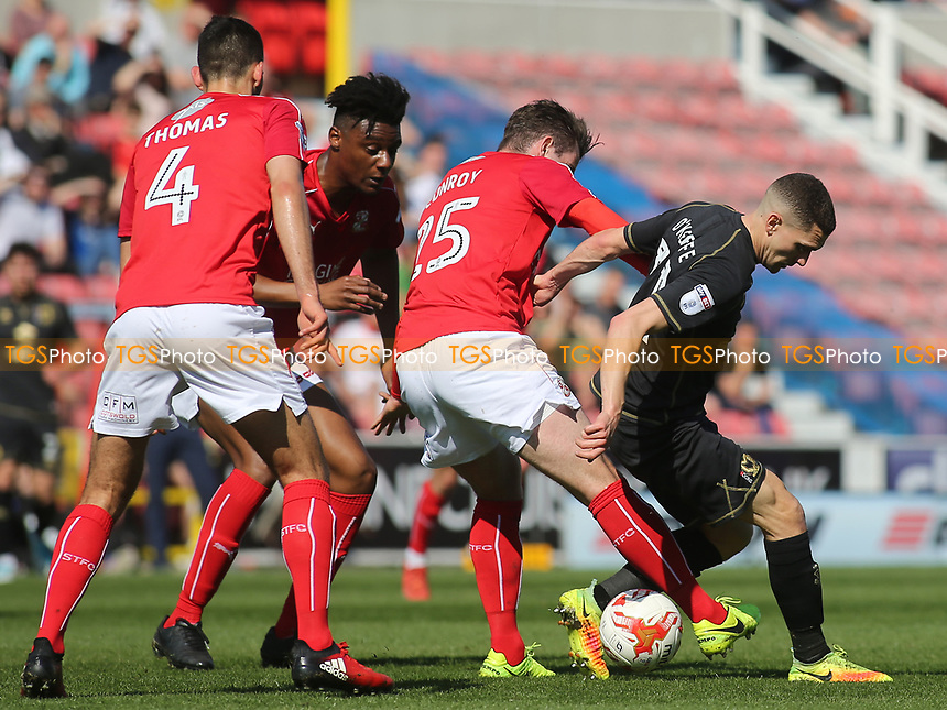 Dion Conroy of Swindon Town and MK Dons Stuart O'Keefe challenge for the ball during Swindon Town vs MK Dons, Sky Bet EFL League 1 Football at the County Ground on 8th April 2017