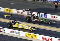 Sep 15, 2013; Charlotte, NC, USA; NHRA top fuel dragster driver Morgan Lucas (near lane) races alongside Terry McMillen during the Carolina Nationals at zMax Dragway. Mandatory Credit: Mark J. Rebilas-