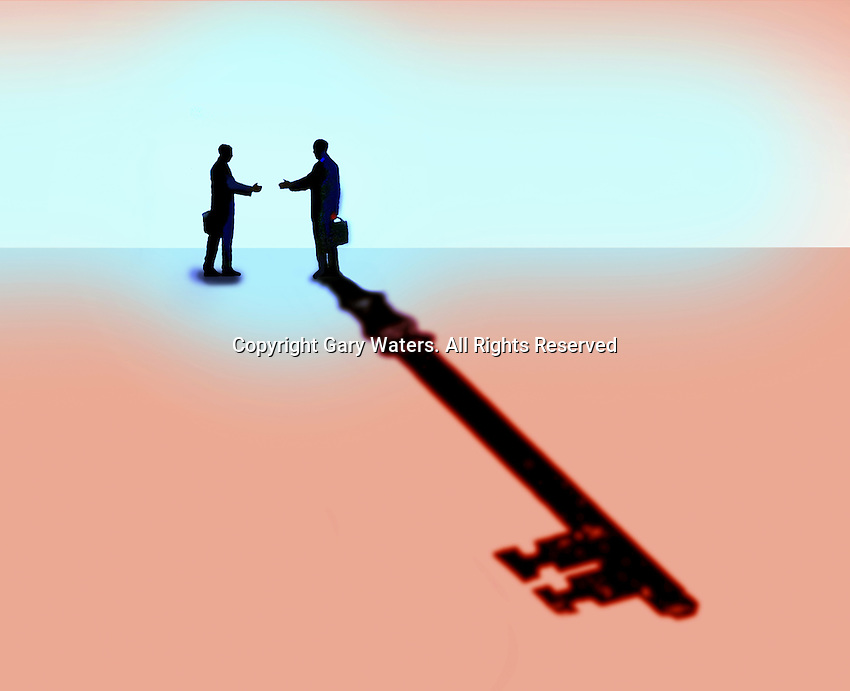 Man shaking hands with businessman casting key shadow