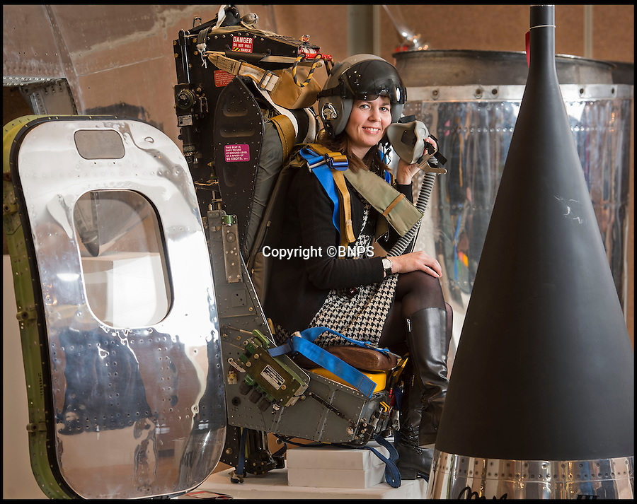 BNPS.co.uk (01202 558833)<br /> Pic: PhilYeomans/BNPS<br /> <br /> Cold war hardware turning into hot property...<br /> <br /> Christie's Head of Decorative Arts Anna Evans in the ejector seat from a Lightning interceptor.<br /> <br /> Cold war collectables - Up market auction house Christie's has spotted a trend for cold war technology as high tech feature furniture for the modern collector.<br /> <br /> The Kensington auctioneers, normally associated with marble sculptures and Old Masters, are selling a collection of items as eclectic and diverse as a highly polished nose cone from a french Mirage jet, the ejector seat from a supersonic British Lightning and the tail fin from a missile.<br /> <br /> Anna said 'The aeronautic objects are interesting pieces of history as well dynamic items which make high-impact displays. There are increasing numbers of people with a passion for aviation looking for these bold, sculptural pieces of history.'<br /> <br /> Christies's - 17th Feb - London.