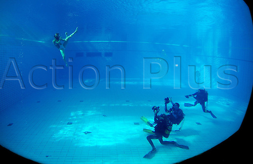 German kickboxing champion Christine Theiss performs a move under water in a swimming hall in Munich, Germany, 19 November 2009. Theiss supported German video artist Felix Hoerhager in his interpretation of Hermann Hesse's 'Siddartha'. Photo: Tobias Hase/actionplus.  UK Editorial Licenses Only