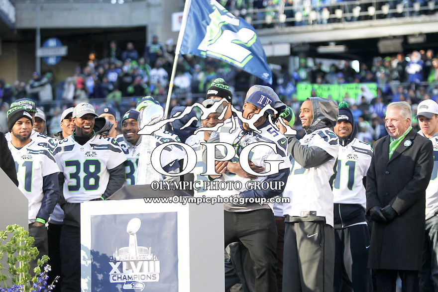 2014-02-05:  Seattle Seahawk Bobby Wagner photo bombed in the main stage during celebration on the field.  Seattle Seahawks players and 12th man fans celebrated bringing the Lombardi trophy home to Seattle during the Super Bowl Parade at Century Link Field in Seattle, WA.