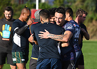 New Zealand Deaf Rugby Football Union players known as the Deaf Blacks play a game of touch with the Warriors in support of Sign Language Week. Vodafone Warriors training session. Mt Smart Stadium, Auckland, New Zealand. NRL Rugby League. Wednesday 9 May 2018 © Copyright photo: Andrew Cornaga / www.photosport.nz