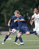 Quinnipiac University defender Matthew Rothbart (14) clears the ball. Boston College defeated Quinnipiac, 5-0, at Newton Soccer Field, September 1, 2011.
