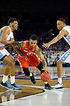 02 APR 2016: Forward Michael Gbinije (0) of Syracuse University drives between Forward Kennedy Meeks (3) and Forward Brice Johnson (11) of the University of North Carolina during the 2016 NCAA Men's Division I Basketball Final Four Semifinal game held at NRG Stadium in Houston, TX. North Carolina defeated Syracuse 83-66 to advance to the championship game.  Brett Wilhelm/NCAA Photos