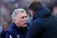 29th February 2020; London Stadium, London, England; English Premier League Football, West Ham United versus Southampton; West Ham United Manager David Moyes greets Southampton Manager Ralph Hasenhuttl from the dugout