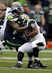 Seattle Seahawks defensive tackle Tony McDonald (99) dances after dropping Jacksonville Jaguars running back Maurice Jones-Drew for a loss at CenturyLink Field in Seattle, Washington on September 22, 2013.   Seahawks beat the Jaguars 45-17.  ©2013. Jim Bryant Photo. ALL RIGHTS RESERVED.