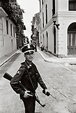 PANAMA, Panama City, a young soldier walks the streets of Old Town Panama City, Central America (B&W)