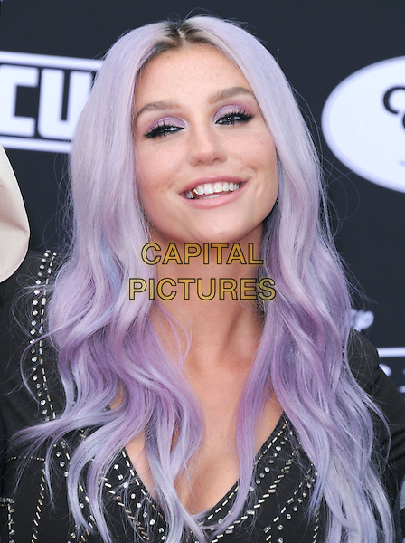 Kesha Rose Sebert  attends The Disney 'Planes: Fire &amp; Rescue' premiere held at The El Capitan Theatre in Hollywood, California on July 15,2014                                                                               <br /> CAP/DVS<br /> &copy;DVS/Capital Pictures