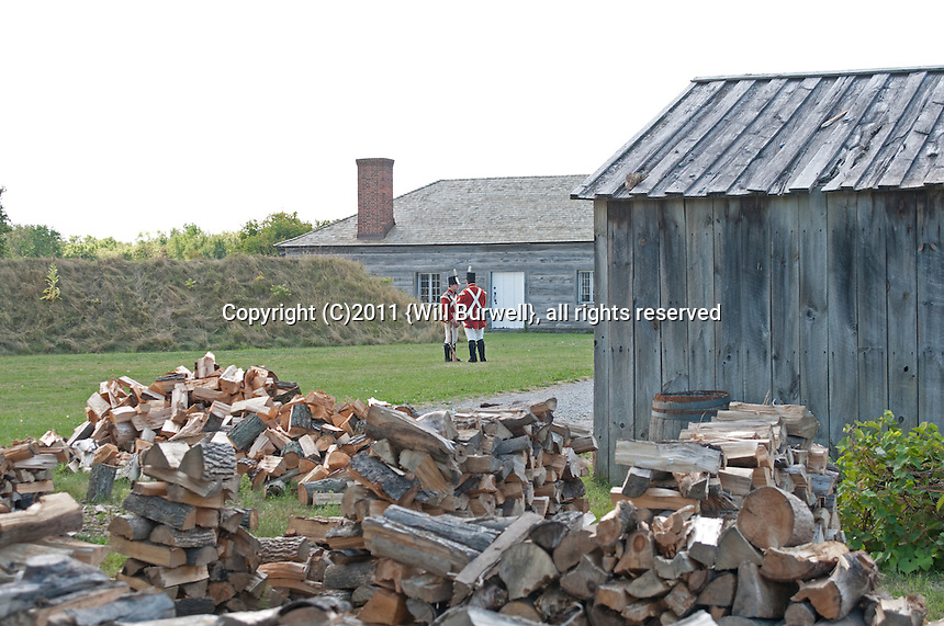 View of Red coat soldiers over wood pile