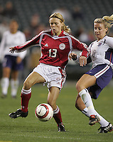 06 November,  2004. Denmark's Nadia Kjaeldgaard (13) fights with Aly Wagner (10) of the USMNT  at  Lincoln Financial Field in Philadelphia, Pa.