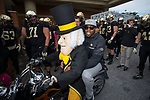 Former Wake Forest Demon Deacons and NFL star Calvin Pace rides on the back of the Demon Deacon's motorcycle prior to the game against the Louisville Cardinals at BB&T Field on October 28, 2017 in Winston-Salem, North Carolina.  The Demon Deacons defeated the Cardinals 42-32.  (Brian Westerholt/Sports On Film)
