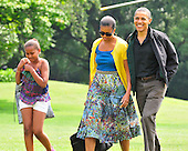 United States President Barack Obama and his family return to the South Lawn of the White House in Washington, D.C. from a weekend at Camp David, the presidential retreat near Thurmont, Maryland.  From left to right: Sasha Obama, first lady Michelle Obama; and President Obama..Credit: Ron Sachs / Pool via CNP