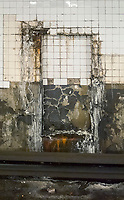 """The damaged and dirty tile wall in the World Trade Center station at the terminus of the IND """"E"""" line in New York on Sunday, June 11, 2017. Richard B. Levine)"""