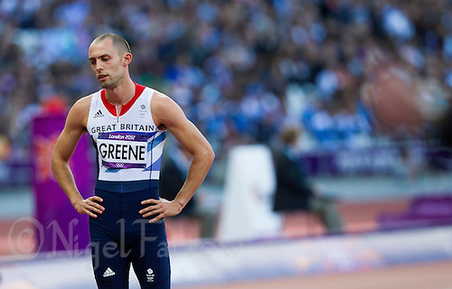 04 AUG 2012 - LONDON, GBR - Dai Greene (GBR) of Great Britain recovers after finishing in the first men's 400m Hurdles semi final at the London 2012 Olympic Games athletics at the Olympic Stadium in the  Olympic Park, Stratford, London, Great Britain .(PHOTO (C) 2012 NIGEL FARROW)