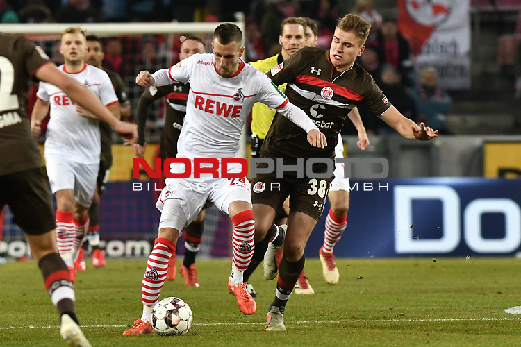 08.02.2019, Rheinenergiestadion, Köln, GER, DFL, 2. BL, VfL 1. FC Koeln vs FC St. Pauli, DFL regulations prohibit any use of photographs as image sequences and/or quasi-video<br /> <br /> im Bild v. li. im Zweikampf Dominick Drexler (#24, 1.FC Köln / Koeln) Florian Carstens (#38, FC St. Pauli) <br /> <br /> Foto © nph/Mauelshagen