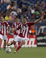 Chivas USA midfielder Blair Gavin (18) passes the ball. In a Major League Soccer (MLS) match, Chivas USA defeated the New England Revolution, 3-2, at Gillette Stadium on August 6, 2011.