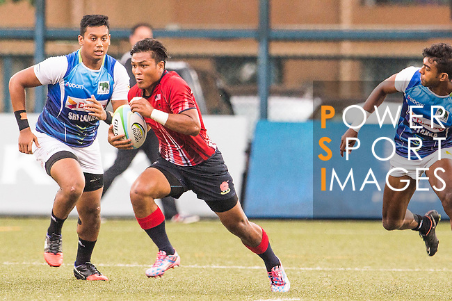 Muhammad Fitri Bin Abdullah (l) of Malaysia in action against Sri Lanka's players during the match between Sri Lanka and Malaysia of the Asia Rugby U20 Sevens Series 2016 on 12 August 2016 at the King's Park, in Hong Kong, China. Photo by Marcio Machado / Power Sport Images