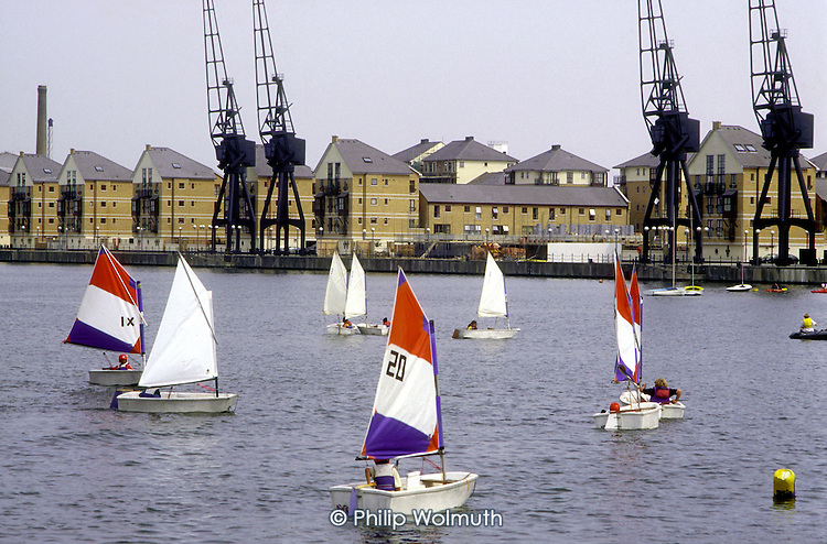 The Royal Victoria Dock, in Newham, East London, is now a centre for water sports overlooked by new luxury housing developments.