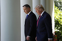US President Donald J. Trump (R), with Polish President Andrzej Duda (L), arrive to a joint press conference in the Rose Garden of the White House in Washington, DC, USA, 12 June 2019. Earlier President Trump and President Duda signed an agreement to increase military to military cooperation including the purchase of F-35 fighter jets by Poland and an increased US troop presence in Poland. <br /> Credit: Shawn Thew / Pool via CNP/AdMedia