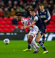 11th January 2020; Bet365 Stadium, Stoke, Staffordshire, England; English Championship Football, Stoke City versus Milwall FC; Murray Wallace of Millwall tackles Tyrese Campbell of Stoke City - Strictly Editorial Use Only. No use with unauthorized audio, video, data, fixture lists, club/league logos or 'live' services. Online in-match use limited to 120 images, no video emulation. No use in betting, games or single club/league/player publications