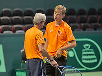 Swiss, Genève, September 14, 2015, Tennis,   Davis Cup, Swiss-Netherlands, practise Dutch team, Tallon Griekspoor listen to the explanation of coach Martin Bohm<br /> Photo: Tennisimages/Henk Koster